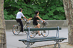 Dog with couple riding bikes (velib), Paris, France. .  John offers private photo tours in Denver, Boulder and throughout Colorado, USA.  Year-round. .  John offers private photo tours in Denver, Boulder and throughout Colorado. Year-round.