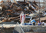 A statue of Jesus sits amongst the debris where homes previously stood on Brooke Avenue in Union Beach, New Jersey.  Photo By Bill Denver