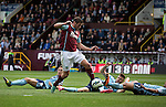 Burnley 1 West Ham United 3, 18/10/2014. Turf Moor, Premier League. Burnley striker Lukas Jutkiewicz evades three challenges against West Ham United in an English Premier League match at Turf Moor. The fixture was won by the visitors by three goals to one watched by 18,936 spectators. The defeat meant that Burnley still had not won a league match since being promoted from the Championship the previous season. Photo by Colin McPherson.