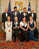 The five recipients of the 40th Annual Kennedy Center Honors pose for a group photo following a dinner hosted by United States Secretary of State Rex Tillerson in their honor at the US Department of State in Washington, D.C. on Saturday, December 2, 2017.  From left to right back row: US Secretary of State Rex Tillerson, LL Cool J, Lionel Richie, and David M. Rubenstein, Chairman, John F. Kennedy Center for the Performing Arts.  Front row, left to right: Carmen de Lavallade, Norman Lear, Gloria Estefan and Deborah F. Rutter, President of the John F. Kennedy Center for the Performing Arts.  The 2017 honorees are: American dancer and choreographer Carmen de Lavallade; Cuban American singer-songwriter and actress Gloria Estefan; American hip hop artist and entertainment icon LL COOL J; American television writer and producer Norman Lear; and American musician and record producer Lionel Richie.  <br /> Credit: Ron Sachs / Pool via CNP /MediaPunch NortePhoto.com. NORTEPHOTOMEXICO