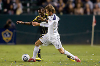 LA Galaxy midfielder David Beckham battles with Columbus Crew midfielder Shaun Francis. The LA Galaxy defeated the Columbus Crew 3-1 at Home Depot Center stadium in Carson, California on Saturday Sept 11, 2010.
