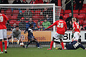 Chuks Aneke of Crewe (26) scores past Anthony Grant and Steve Arnold of Stevenage (l). Crewe Alexandra v Stevenage - npower League 1 - The Alexandra Stadium, Gresty Road, Crewe - 5th January, 2013. © Kevin Coleman 2013.