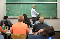Professor Ron Buckmire works with his Math 340 class, Ordinary Differential Equations, in Fowler Hall on Oct. 19, 2015<br /> (Photo by Marc Campos, Occidental College Photographer)