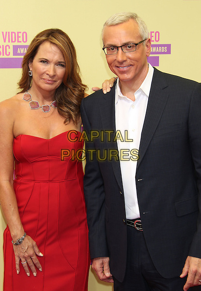 Dr. Drew Pinsky.2012 MTV Video Music Awards held at Staples Center, Los Angeles, California, USA 6th September 2012..vmas vma arrivals  half length strapless red dress suit glasses white shirt .CAP/ADM/RE.©Russ Elliot/AdMedia/Capital Pictures.