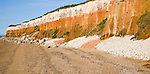 Chalk, red chalk and carstone form striped cliffs of white, red and orange at Hunstanton, Norfolk, England