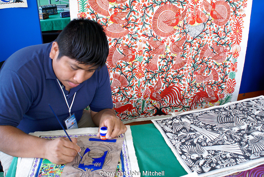 Indigenous artist worrking on a traditional Amate paper painting, Guerrero, Mexico