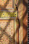 A detail of a painted door and a lock in the Bahia Palace in Marrakesh, Morocco.