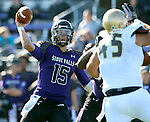 SIOUX FALLS, SD - OCTOBER 18: Luke Papilion #15 from the University of Sioux Falls looks for a receiver against Southwest Minnesota State in the second half of their game Saturday afternoon at Bob Young Field in Sioux Falls. (Photo by Dave Eggen/Inertia)
