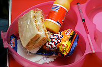 Children's lunch box with sandwich,drink, and bag of snacks