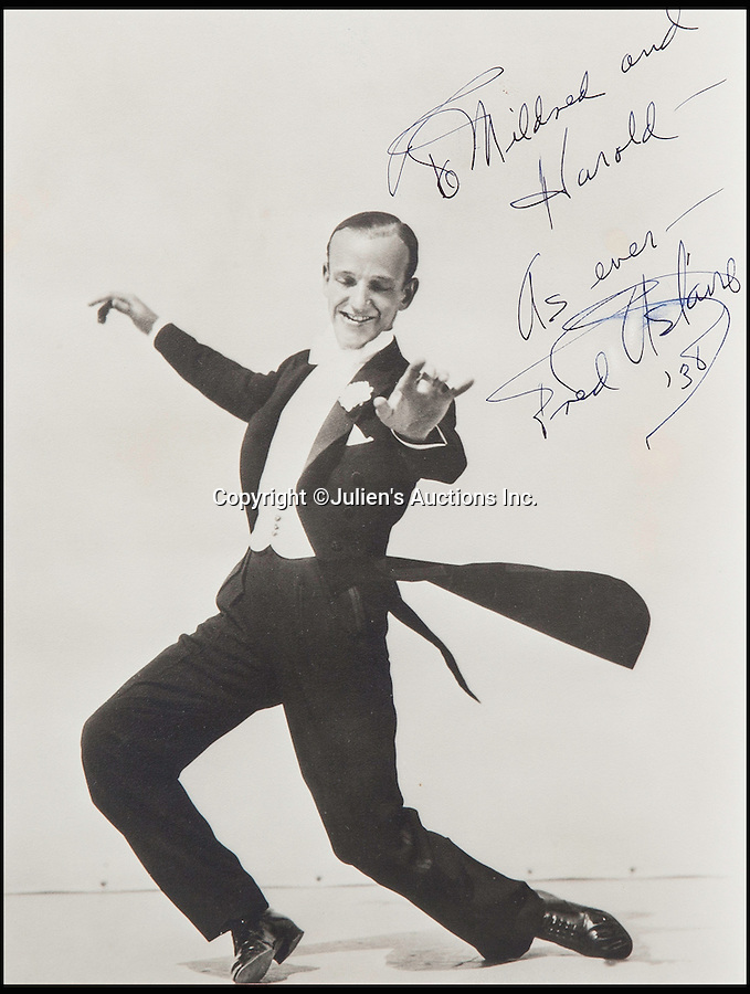 BNPS.co.uk (01202 558833)<br /> Pic: JuliensAuctions/BNPS<br /> <br /> American dancer, singer and actor Fred Astaire. <br /> <br /> The Rogues Gallery - Unique Who's who from the halcyon days of Hollywood, collected by one of their own, comedian Harold Lloyd.<br /> <br /> The silent movie actor asked his silver screen chums to send him their best loved publicity shots one Xmas, so he could create a 'Rogues Gallery' at his Hollywood mansion.<br /> <br /> The unique collection reveals tinsel town as it preferred to see itself in its most glamourous era between the wars.