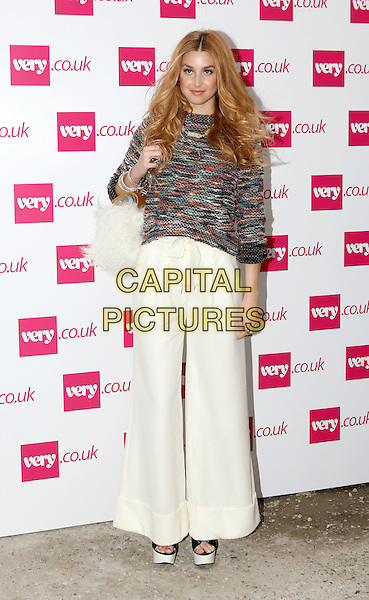 Whitney Port.The Very.co.uk Fashion Preview for Spring and Summer 2012, Mercer Studios, London, England..September 20th, 2011.LFW full length black green orange knitted jumper sweater top white cream wide leg flared trousers .CAP/ROS.©Steve Ross/Capital Pictures