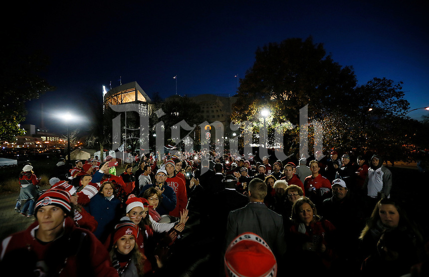 The Ohio State Buckeyes head to the stadium surrounded by the fans before the college football game between the Ohio State Buckeyes and the Minnesota Golden Gophers at Ohio Stadium in Columbus, Saturday night, November 7, 2015. The Ohio State Buckeyes defeated the Minnesota Golden Gophers 28 - 14. (The Columbus Dispatch / Eamon Queeney)