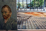 May 13, 2010 - Tokyo, Japan - A reproduction of a Vincent van Gogh self-portrait made of 2,070 polo shirts in 24 different colors is pictured at Marunouchi Building, Tokyo, Japan, on May 13, 2010.The mosaic was created by Tokyo-based apparel maker Onward Kashiyama Co. as part of its campaign to incorporate colors of paintings into clothing designs.