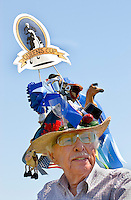 A man shows off his themed hat during the Queen's Cup Steeplechase in Mineral Springs, NC.