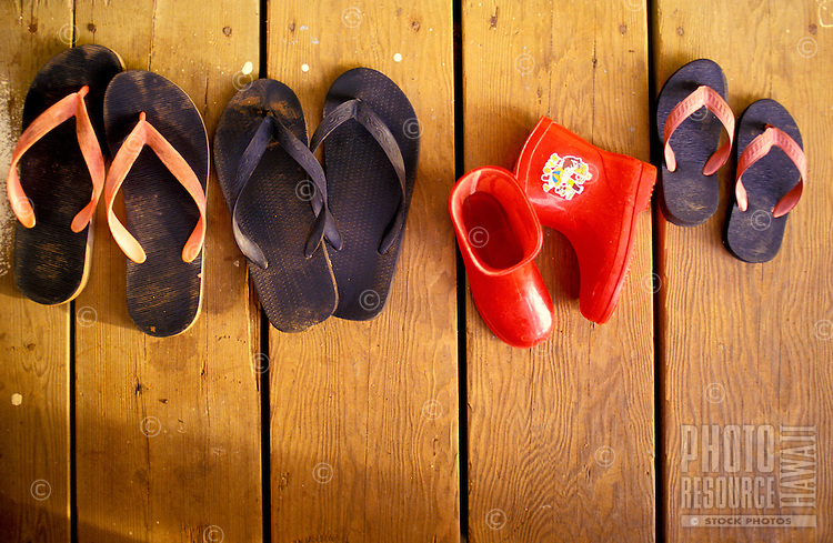 Rubber slippers commonly seen at the front door of local homes