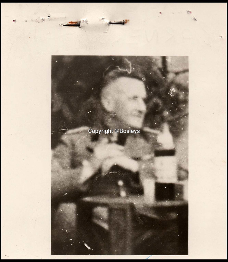 BNPS.co.uk (01202 558833)Pic: Bosleys/BNPS<br /> <br /> ID photo of SS officer Fritz Barnekow.<br /> <br /> Paper Trail...Sqn Ldr frank McKenna's meticulous investigation is revealed in the fascinating dossier.<br /> <br /> Remarkable top secret documents relating to the investigation into the murder of 50 prisoners of war who took part in the Great Escape have come to light.<br /> <br /> The papers made up a dossier put together by the RAF Special Investigation Branch which had the job of finding the German killers of the Allied airmen who took part in the high-profile escape.<br /> <br /> The documents, that include custody mugshot photos and fingerprints of Gestapo suspects, have been put up for sale through Bosley's Auctioneers.