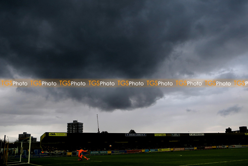 Dark clouds gather above the ground as half-time approaches during AFC Wimbledon vs Lincoln City, Emirates FA Cup Football at the Cherry Red Records Stadium on 4th November 2017