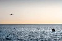 Lampedusa, 29 Giugno, 2008. Uomini della Capitaneria di Porto impegnati nelle operazioni di ricerca e salvataggio di immigrati.<br /> A boat of african immigrants in the meadle of Mediterranean sea