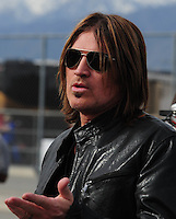Feb 21, 2009; Fontana, CA, USA; Former singer Billy Ray Cyrus in the garage during practice for the Auto Club 500 at Auto Club Speedway. Mandatory Credit: Mark J. Rebilas-