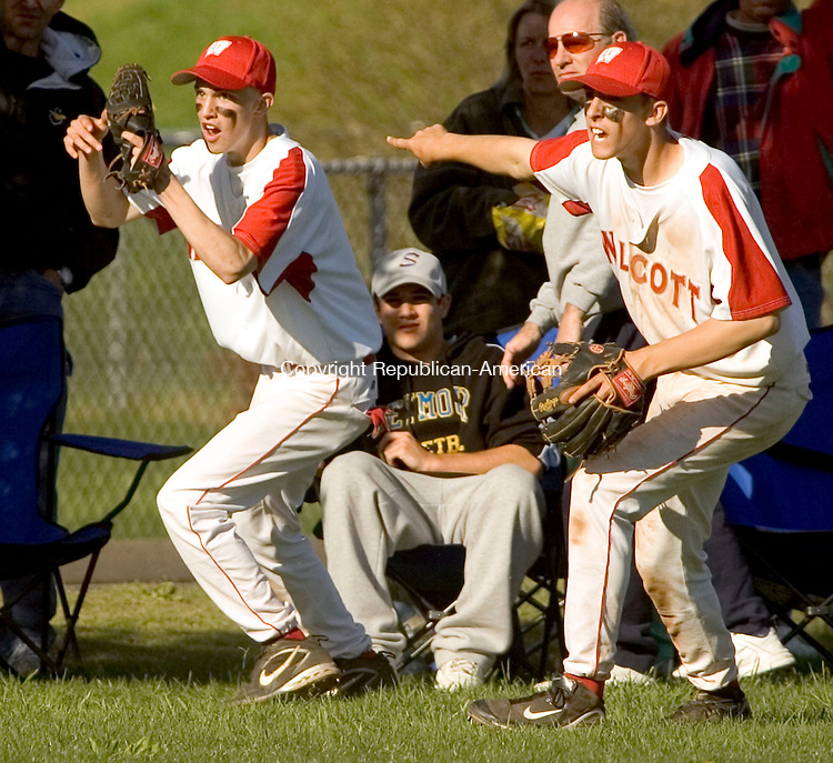 WOLCOTT, CT--02 MAY 2007--050207JS09- Wolcott's David Antonucci (2), left, and teammate Ryan Pelletier (4)  indicate that Antonucci caught the ball to end the game during their 7-5 win over Seymour Wednesday at the BAW field in Wolcott. <br /> Jim Shannon/Republican-American