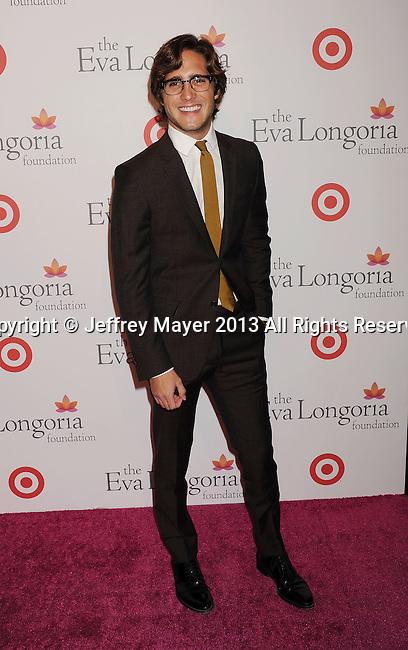 HOLLYWOOD, CA- SEPTEMBER 28: Actor Diego Boneta arrives at the Eva Longoria Foundation Dinner at Beso restaurant on September 28, 2013 in Hollywood, California.