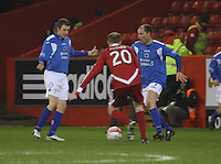 Allan Johnston (right ) being closed down by Stephen Hughes as Chris Higgins looks on in the Aberdeen v Queen of the South William Hill Scottish Cup 5th Round match played at Pittodrie Stadium, Aberdeen on 4.2.12.