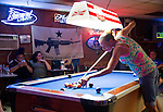 "A ""Come and Take It"" flag showing an assault rifle  hangs at Ronnie's One Oak bar in Bastrop, Texas."