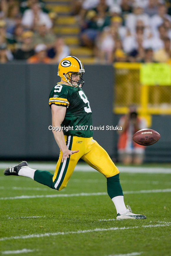 Punter Jon Ryan of the Green Bay Packers punts the ball during an NFL football game against the Chicago Bears at Lambeau Field on October 7, 2007 in Green Bay, Wisconsin. The Bears beat the Packers 27-20. (Photo by David Stluka)