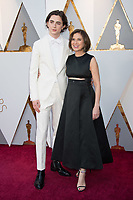 Timoth&eacute;e Chalamet, Oscar&reg; nominee for actor in a leading role, arrives with a guest for the live ABC Telecast of The 90th Oscars&reg; at the Dolby&reg; Theatre in Hollywood, CA on Sunday, March 4, 2018.<br /> *Editorial Use Only*<br /> CAP/PLF/AMPAS<br /> Supplied by Capital Pictures