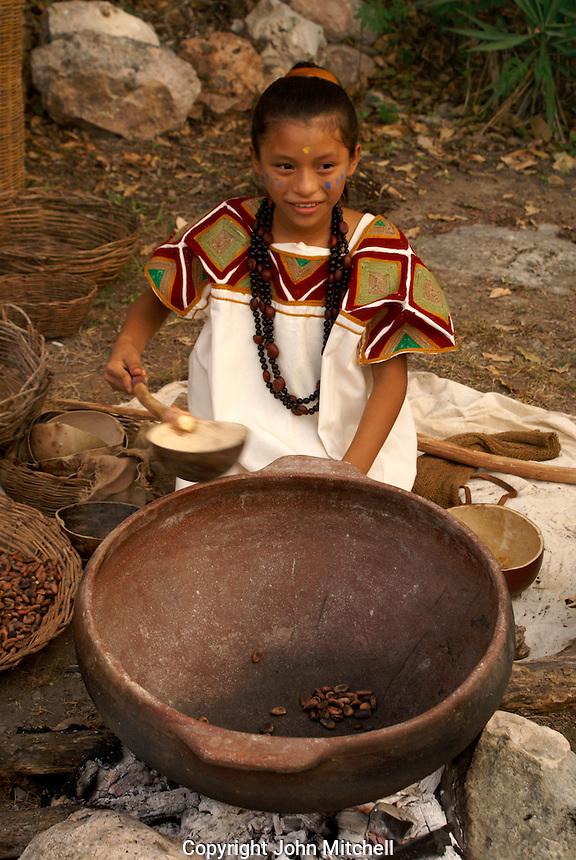 Maya girl roasting cacao beans at the recreation of an ancient Mayan market, Sacred Mayan Journey 2011 event, Riviera Maya, Quintana Roo, Mexico