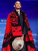 US President Barack Obama receives a traditional blanket and hat during a blanketing ceremony at the 2016 White House Tribal Nations Conference at the Andrew W. Mellon Auditorium, September 26, 2016, Washington, DC.  <br /> The conference provides tribal leaders with opportunity to interact directly with federal government officials and members of the White House Council on Native American Affairs. <br /> Credit: Aude Guerrucci / Pool via CNP