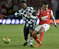 BOGOTÁ -COLOMBIA, 22-03-2014. Yulian Anchico (Der.) jugador de Independiente Santa Fe disputa el balón con Jairo Castillo (Izq.) jugador de Boyaca Chico FC, durante partido por la fecha 12 de la Liga Postobon I-2014, jugado en el estadio Nemesio Camacho El Campin de la ciudad de Bogota. / Yulian Anchico (R) jugador of Independiente Santa Fe vies for the ball with Jairo Castillo (L) player of Boyaca Chico FC during a match for the 12th date of the Liga Postobon I-2014 at the Nemesio Camacho El Campin Stadium in Bogota city. Photo: VizzorImage/ Gabriel Aponte / Staff