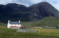 The fishing lodge at Camasunary Bay is dwarfed by the Cuillin Mountains beyond