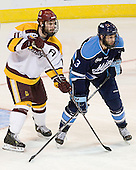 Travis Oleksuk (Duluth - 11), Mark Nemec (Maine - 3) - The University of Minnesota Duluth Bulldogs defeated the University of Maine Black Bears 5-2 in their NCAA Northeast semifinal on Saturday, March 24, 2012, at the DCU Center in Worcester, Massachusetts.