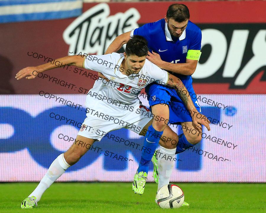 Fudbal<br /> Prijateljski mec-Friendly match<br /> Srbija v Grcka<br /> Aleksandar Mitrovic (L) and Vassilis Torosidis<br /> Chania, 18.11.2014.<br /> foto: Srdjan Stevanovic/Starsportphoto &copy;