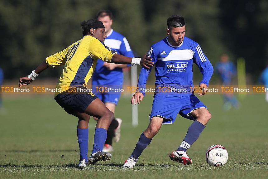 Dynamics (blue) vs Athletico Angels - Hackney & Leyton Sunday League Football at South Marsh, Hackney Marshes, London - 14/10/12 - MANDATORY CREDIT: Gavin Ellis/TGSPHOTO - Self billing applies where appropriate - 0845 094 6026 - contact@tgsphoto.co.uk - NO UNPAID USE.