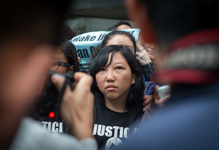 Abused Indonesian domestic helper Erwiana Sulistyaningsih talks to the media on the steps of the District Court in Wan Chai, Hong Kong. She suffered abuse at the hands of Law Wan-tung who was sentenced to six years in prison today.<br /> 27th February 2015. 27.02.15<br /> &copy;Jayne Russell
