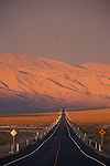 US 95 points toward the Gabbs Valley Range as the sun sets and the skies clear after a summer storm in central Nevada
