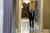 United States Representative John Garamendi (Democrat of California) talks on the phone as he walks into the United States Capitol Building Rotunda on January 20th, 2018 in Washington, D.C. Credit: Alex Edelman / CNP