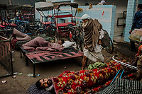 OLD DELHI, INDIA, JANUARY 11, 2016: Men wake-up on the street, after having slept with a rented blanket, at a sleep market on January 11, 2016 in Old Delhi, India. <br /> Daniel Berehulak for The New York Times