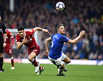 Phil Jagielka of Everton is challenged by Dominic Solanke of Liverpool during the premier league match at Goodison Park Stadium, Liverpool. Picture date 7th April 2018. Picture credit should read: Robin Parker/Sportimage