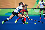 Katie Reinprecht #14 of United States defends during USA vs Germany in a women's quarterfinal game at the Rio 2016 Olympics at the Olympic Hockey Centre in Rio de Janeiro, Brazil.