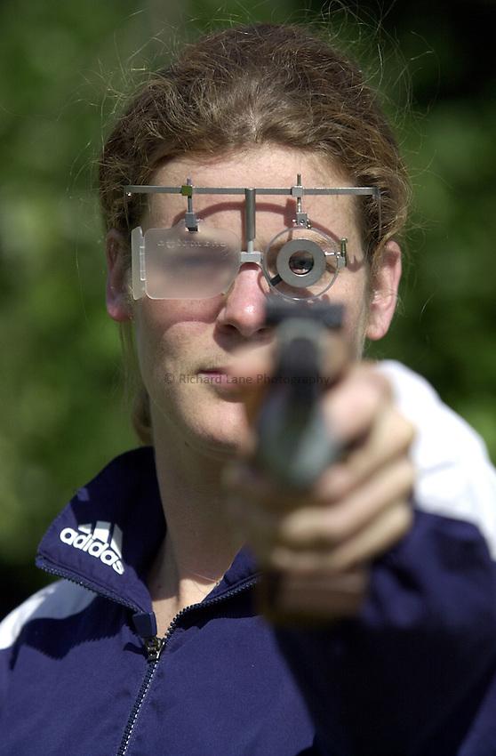 Photo. Richard Lane. 11/7/2000..Kate Allenby with pistol.