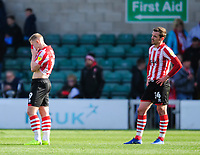 Lincoln City's Danny Rowe, left, and Lincoln City's Harry Toffolo react at the final whistle<br /> <br /> Photographer Chris Vaughan/CameraSport<br /> <br /> The EFL Sky Bet League Two - Lincoln City v Cheltenham Town - Saturday 13th April 2019 - Sincil Bank - Lincoln<br /> <br /> World Copyright &copy; 2019 CameraSport. All rights reserved. 43 Linden Ave. Countesthorpe. Leicester. England. LE8 5PG - Tel: +44 (0) 116 277 4147 - admin@camerasport.com - www.camerasport.com