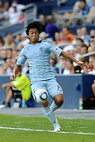Roger Espinoza Sporting KC midfielder keeps the ball in play... Sporting Kansas City defeated Real Salt Lake 2-0 at LIVESTRONG Sporting Park, Kansas City, Kansas.