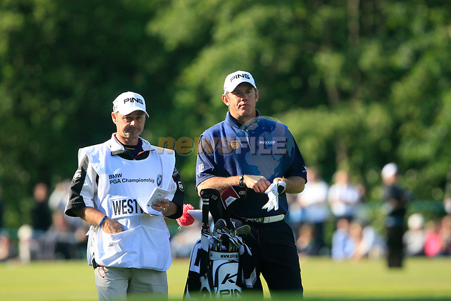 Lee Westwood (ENG) waits to play his 2nd shot on the 18th hole with caddy Billy Foster during the Final Day of the BMW PGA Championship at Wentworth Club, Surrey, England, 29th May 2011. (Photo Eoin Clarke/Golffile 2011)