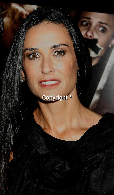 "HOLLYWOOD, CA. - September 03: Demi Moore arrives at the Los Angeles premiere of ""Sorority Row"" at the ArcLight Hollywood theater on September 3, 2009 in Hollywood, California."