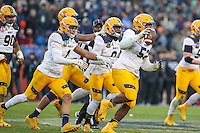 Baltimore, MD - December 10, 2016: Navy Midshipmen defensive end Amos Mason (52) celebrates after recovering a fumble during game between Army and Navy at  M&T Bank Stadium in Baltimore, MD.   (Photo by Elliott Brown/Media Images International)