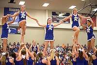 NWA Democrat-Gazette/BEN GOFF @NWABENGOFF<br /> Rogers cheerleaders perform on Friday Sept. 18, 2015 during the homecoming ceremony at Rogers High School.