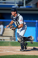Mahoning Valley Scrappers catcher Daniel Salters (12) makes a play on a bunt during the first game of a doubleheader against the Batavia Muckdogs on July 2, 2015 at Dwyer Stadium in Batavia, New York.  Batavia defeated Mahoning Valley 4-1.  (Mike Janes/Four Seam Images)